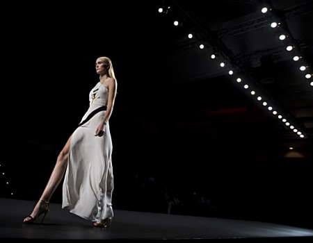 A model displays a Spring/Summer design by Ana Locking during Madrid's Fashion Week, in Madrid, Spain, Friday, Sept. 13, 2013 . (AP Photo/Daniel Ochoa de Olza)