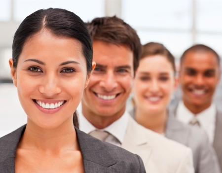 Closeup portrait of confident happy business men and women in a row